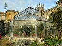 Conservatory glasshouse seen from outside, University of Oxford Botanic Garden, Oxford, Oxfordshire, England, UK